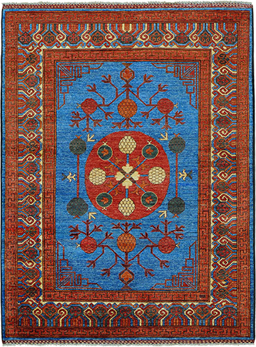 Stunning blue Khotan rug at The Magic Carpet.